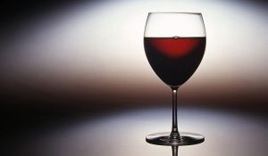 Single Glass photographed on a reflective background with light halo to promote John Russell Product Photography