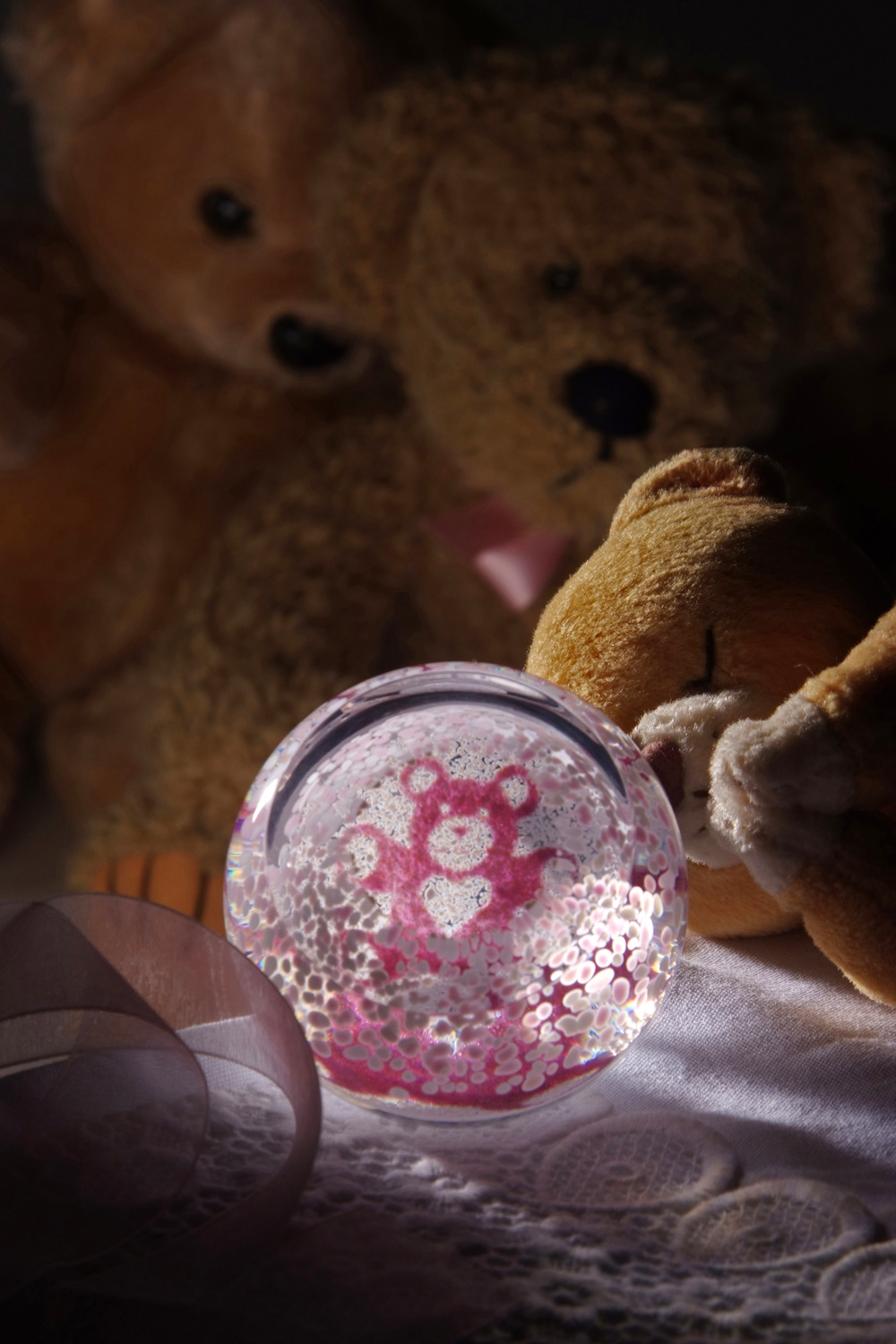 Glass Paperweight by Caithness depicting a pink baby bear