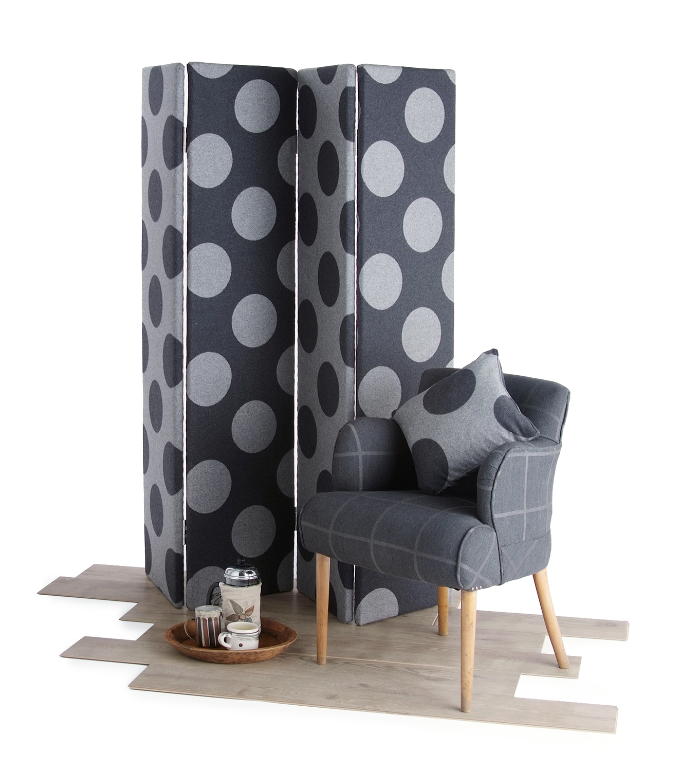 Material screen and armchair on wooden floor