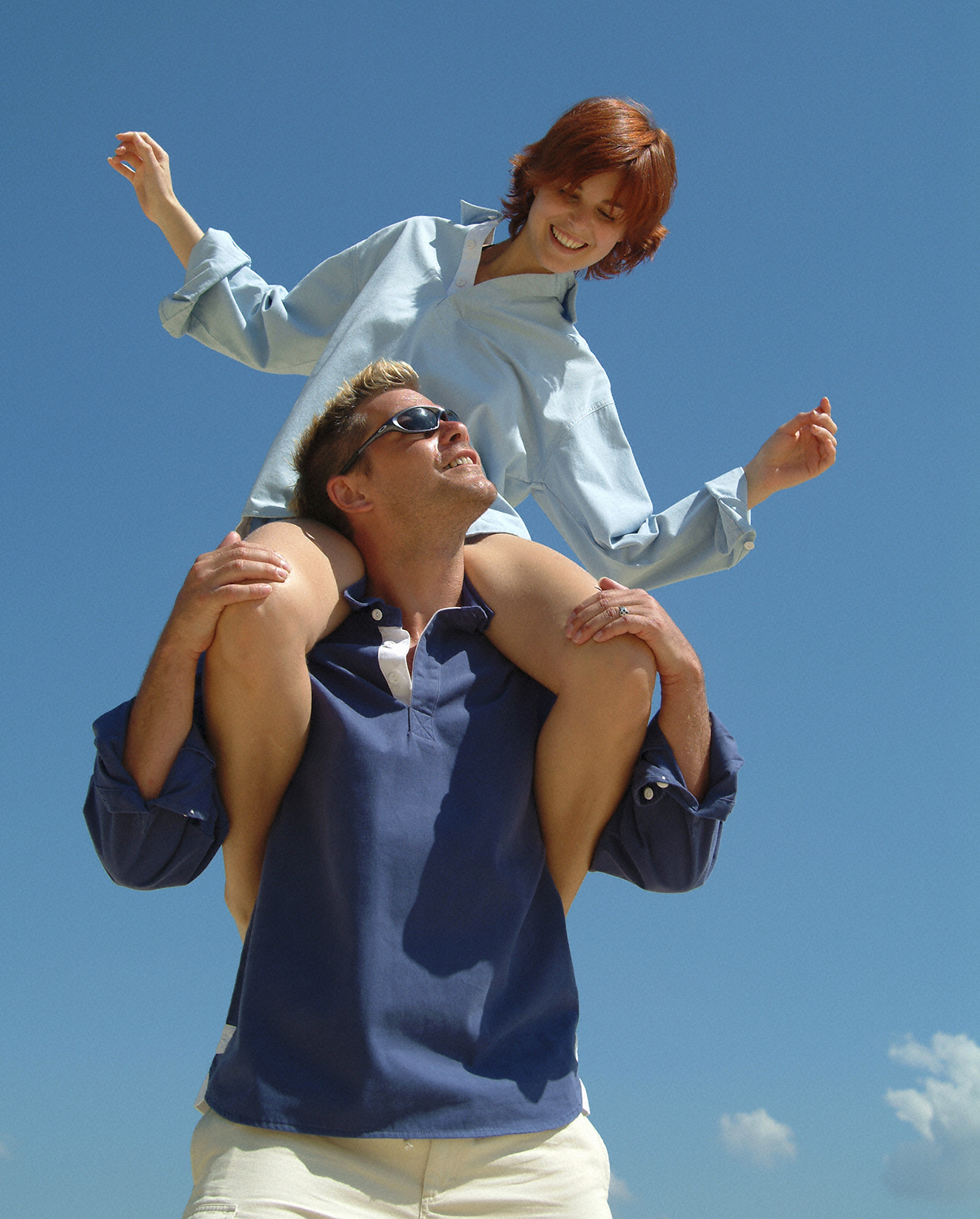 Female model on shoulders of male model.
