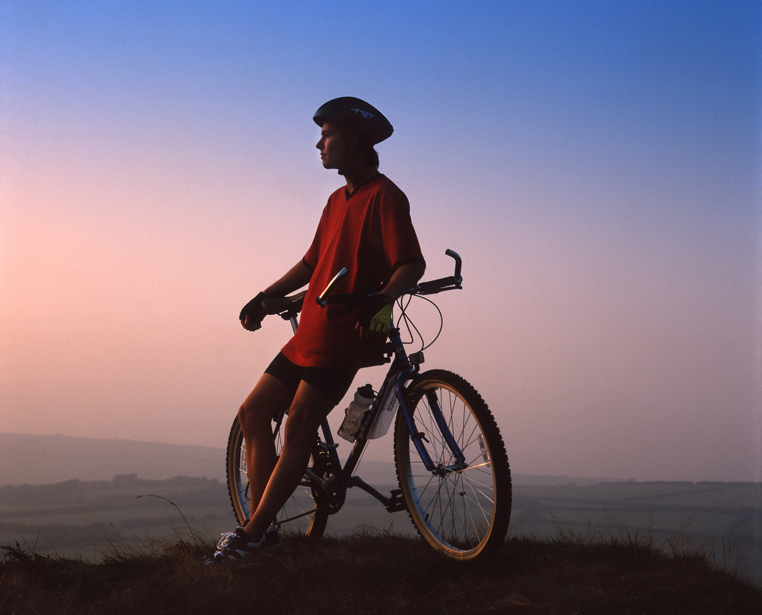 Bike rider in an evening setting to promote John Russell People Photography