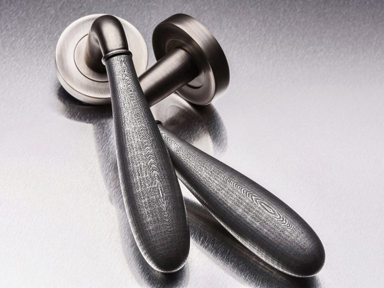 Pair of metal handles shot on a steel background