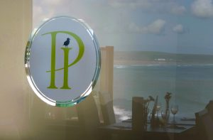 Pier House glass logo and reflection