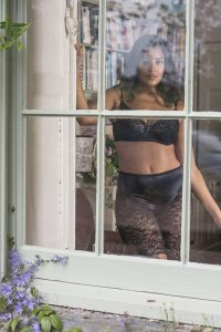 Wearing black lingerie in the window