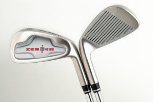 2 Golf clubs on white background
