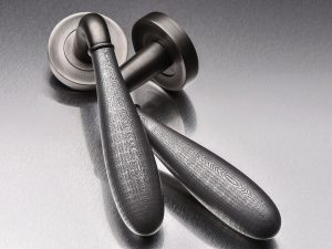 Press Release photography of 2 Door handles