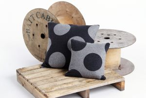 Spotty grey cushions on a pallet